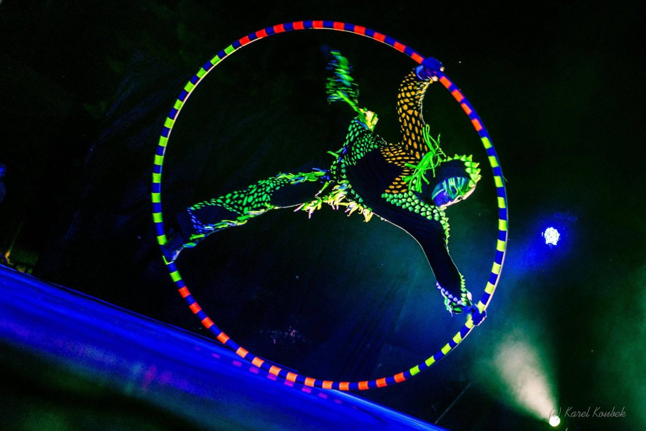 Cyr Wheel Acrobat in UV Light - Black Light Glow Show - Anta Agni