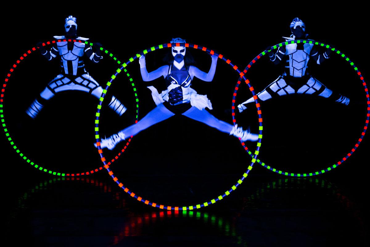 acrobats with Cyr Wheel - UV LED Light Show - Anta Agni acrobatic performance