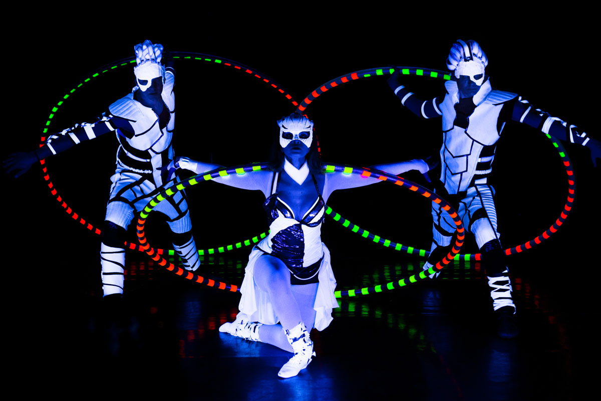 acrobats with Cyr Wheel - UV LED Light Dance Show - Anta Agni acrobatic performance