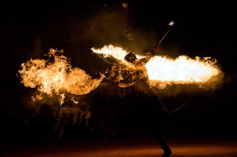 firedancers and flames - dancer with lycopodium torches - anta agni