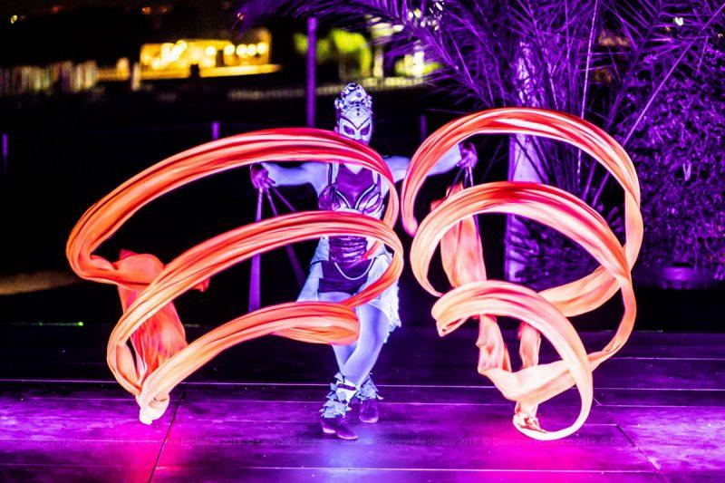 UV Light Show under palm trees